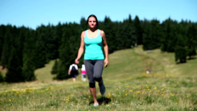 HD WIDE: Young woman jogging video