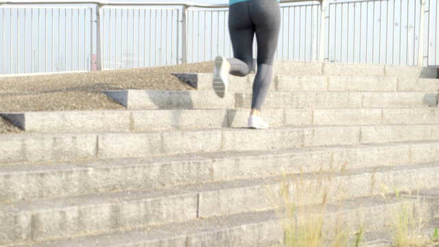 Young woman jogging video