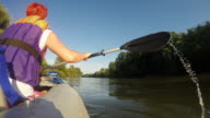 Young woman kayaking on the river video
