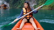 Young woman kayaking video