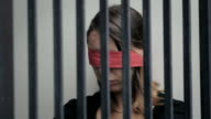 young woman kidnapped and imprisoned in a cell, blindfolded video