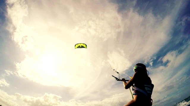 Young Woman Kitesurfing in Ocean video