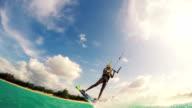 Young Woman Kitesurfing in Ocean video