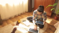 Young woman learning at home. video