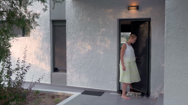Young woman leaving home video