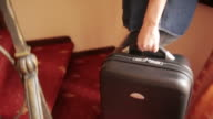 Young woman leaving the hotel room. video