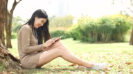 Young woman listening in Park video