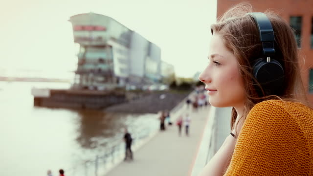 Young woman listening music outdoor video