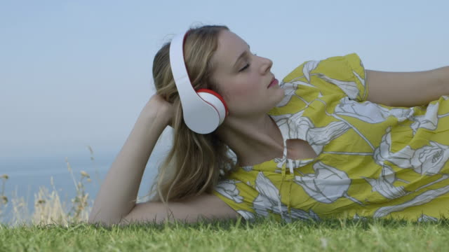 Young woman listening music video