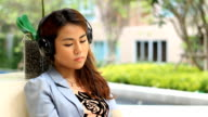 Young woman listening to music and signing video