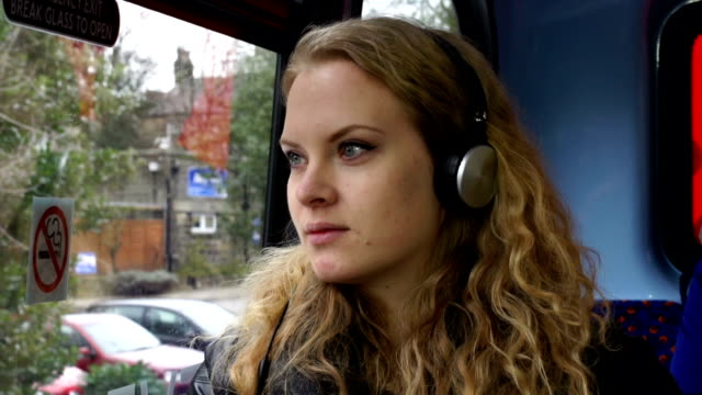 Young woman Listening to Music on the bus video