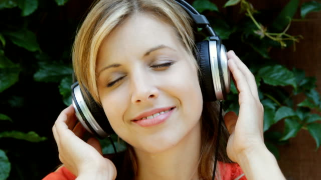 Young woman listens to music. Upbeat. video