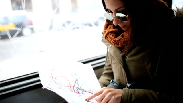 Young woman looking at the map in a transportation video