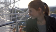 Young woman looking at the view from the ferris wheel video
