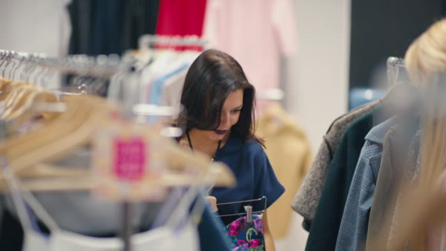 Young Woman Looking New Clothes During Shopping video