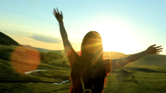 Young woman looking sunset video
