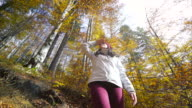 Young woman looking up in the forest. video