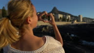 Young woman loving Cape Town, heart shape frame video