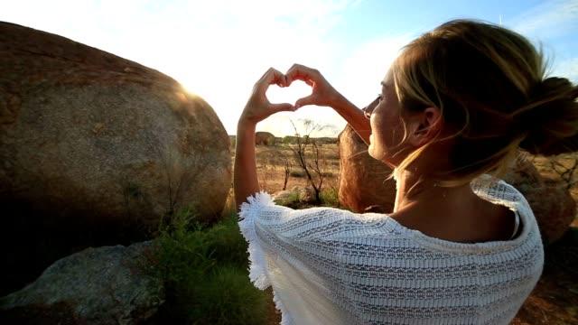 Young woman loving Devil's marble, Australia video