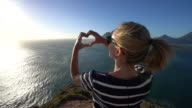 Young woman loving nature, heart shape frame video