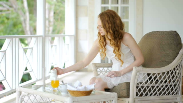 Young woman making breakfast video