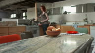 HD: Young Woman Making Herself Breakfast video