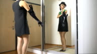 young woman measures the night clothes before the mirror video