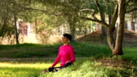 Young woman meditating in the nature video