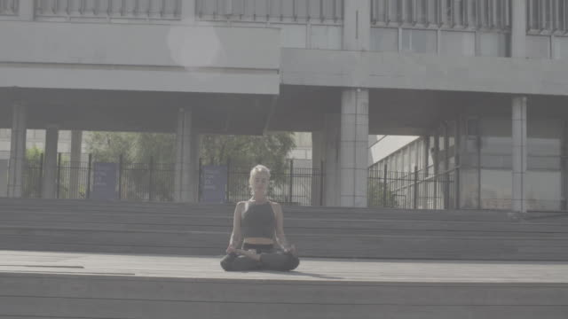 Young woman meditating outdoors video