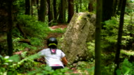 Young woman mountain biking video