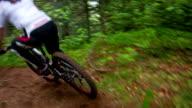 Young woman mountain biking video