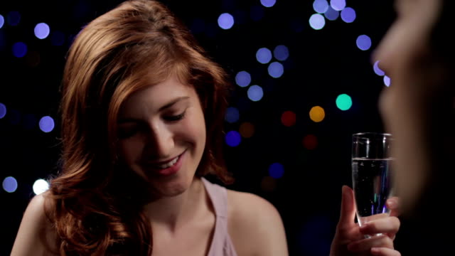 Young woman on a date drinking champagne video