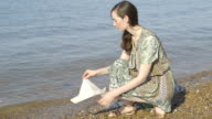 Young woman on beach video