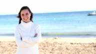 young woman on beach with positive attitude video