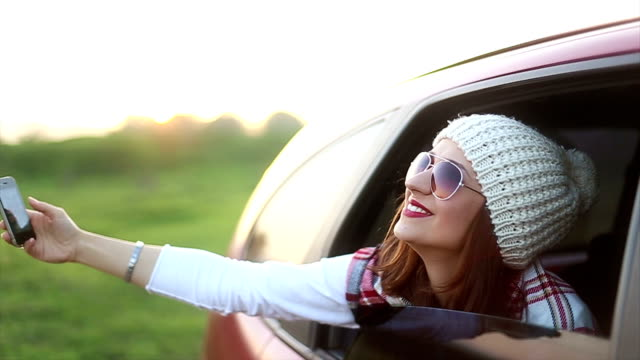 Young woman on road trip taking a selfie video