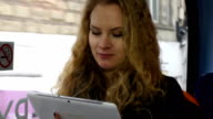 Young woman On the bus with a Digital Tablet video