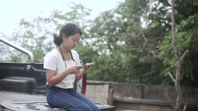 Young woman online banking using smartphone shopping online with credit card. video