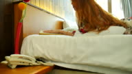 Young woman ordering room service in the hotel. video