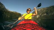 HD: Young woman paddling. video