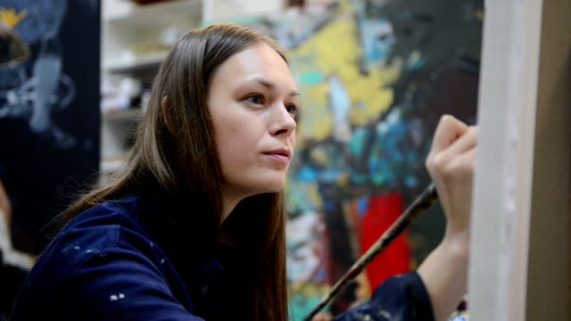 Young woman painter in the art studio video