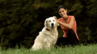 HD DOLLY: Young Woman Petting Her Dog video