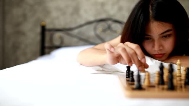 Young woman playing chess video