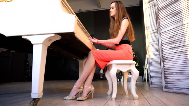 Young woman playing on the grand piano video