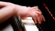 Young woman playing piano video