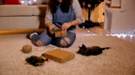 A young woman playing with cat video