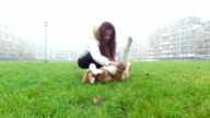Young woman playing with her dog video