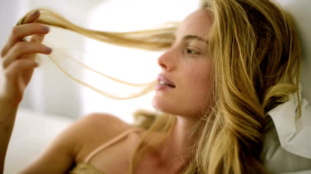 Young woman playing with her hair video