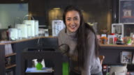 4K SLOW MOTION: Young woman posing nearby a 3D printer video