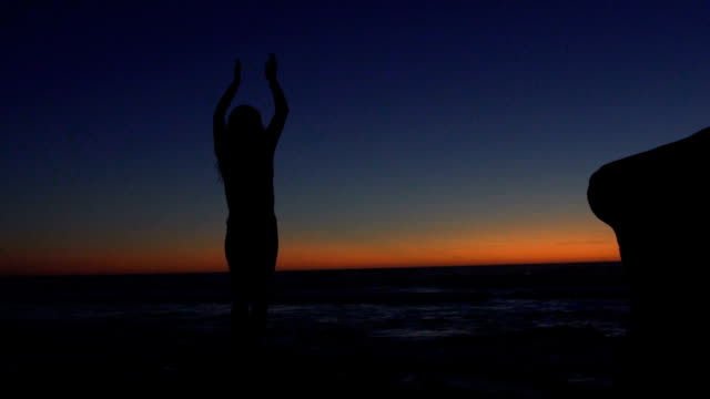 Young Woman Practicing Yoga at the Beach at Sunset, Healthy Active Lifestyle video