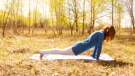 Young woman practicing yoga in a spring forest. video